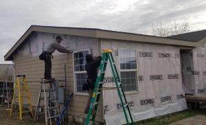 Man installing siding.